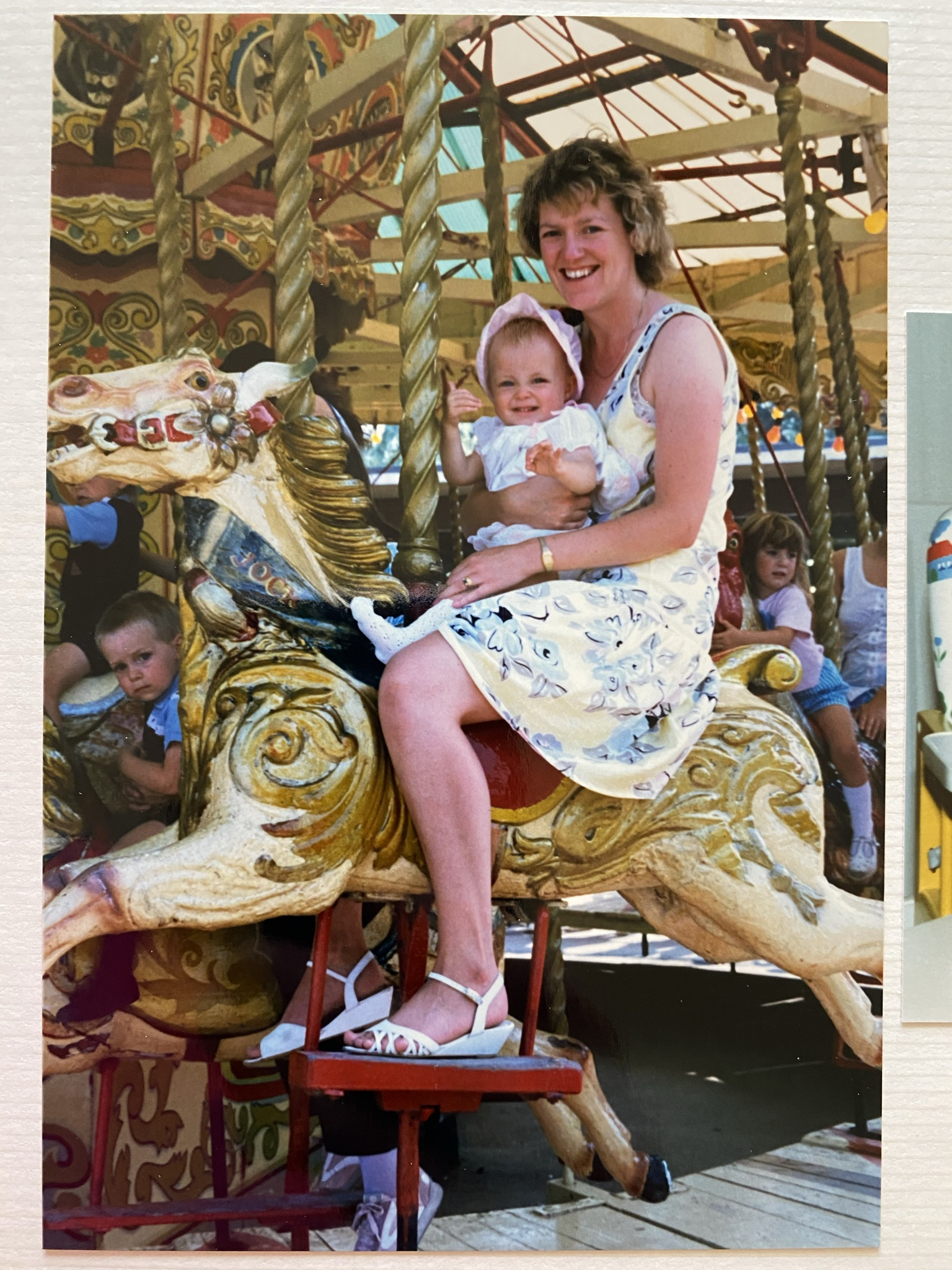 Gill & Jenny on merry go round – first birthday